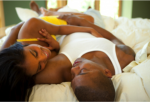 black-man-and-woman-in-bed-300x204