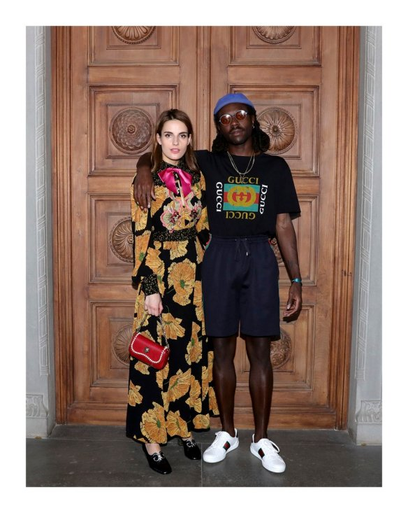 Dev Hynes poses alongside friend at the Gucci resort 2018 fashion show