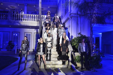 Models all wearing Balmain resort 2018 descending down the staircase